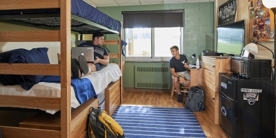 male students in double room with bunked beds