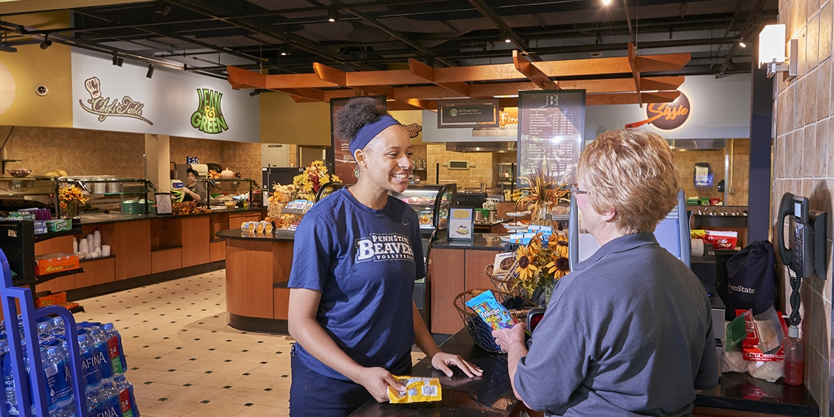 female student being helped by cashier in Brodhead Bistro