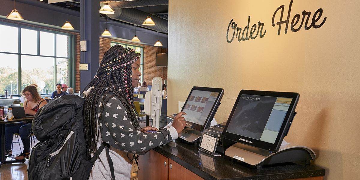 female student ordering at kiosk in Brodhead Bistro
