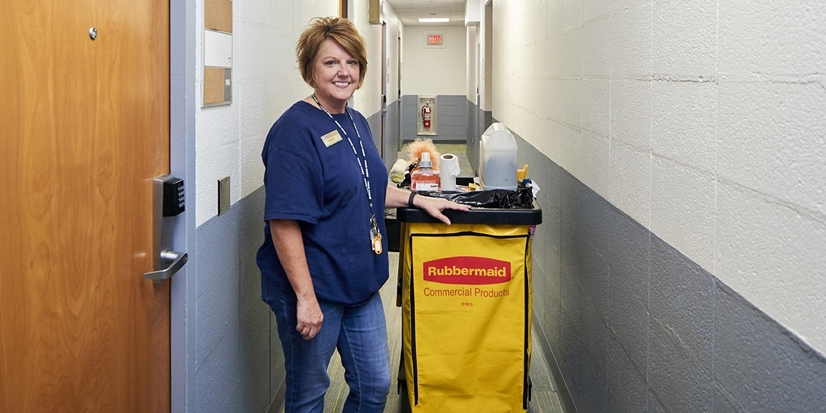 Housekeeper Paula Carlin in a hallway in Harmony Hall